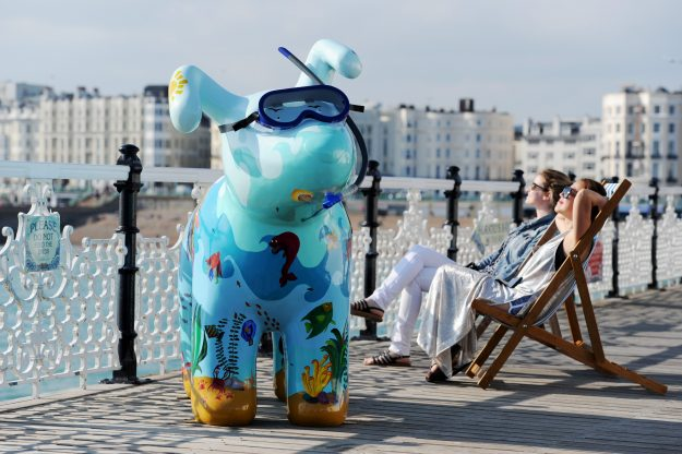 The Martlet's Snowdogs by the Sea campaign on Brighton's Palace Pier this evening The dogs will go on show in September as part of the art trail raising money for the local Martlet's Hospice Please Credit - Simon Dack / Vervate