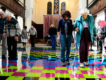 Older visitors travel across brightly lit tile floor