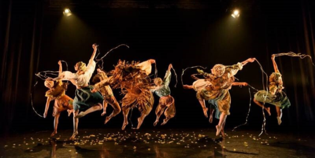Dancers in Rumpelskiltskin leap into the air with ribbons