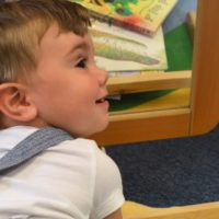 A baby boy looking in a mirror