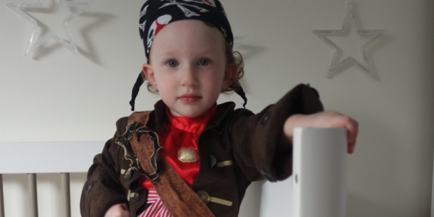 Boy is dressed in pirate costume